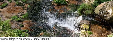 Wonderful Panoramic Landscape With Moss And Stones In The Mountain River. Natural Panoramic Backgrou