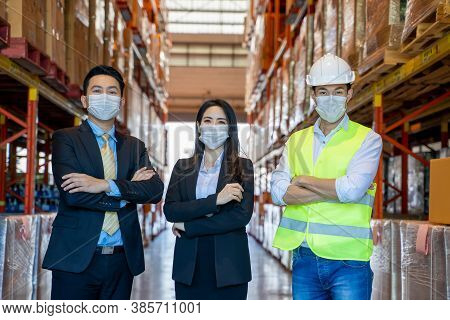 Portrait Of Business People And Worker Wearing Protective Mask To Protect Against Covid-19 Standing