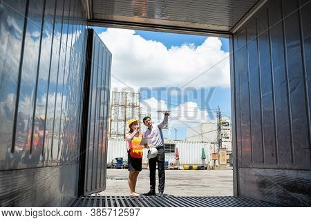 Businessman And Secretary Working Inspecting Online Device In Yard In Container Cargo,industry Of Lo