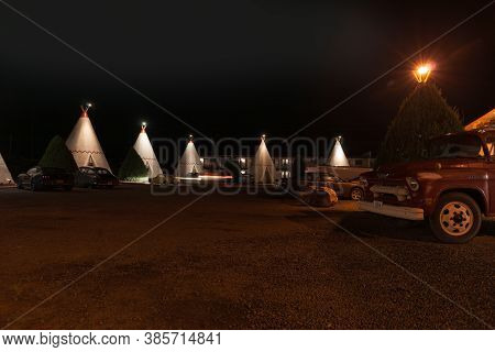 Holbrook Usa - September 22 2015; Wigwam Motel Units With Vehicles Outside At Night On Famous Route