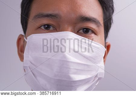 Man With Face Mask Against Virus Bacteria Prevention Outbreak. The Concept Health And Safety, N1h1 C