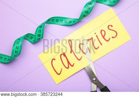 Card With The Word Calories. Cutting Calories. Cutting Calories. Top View