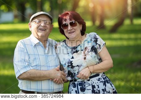 Portrait Of A Happy Elderly Couple. Handsome Man And Woman Senior Citizens. Husband And Wife Of Old