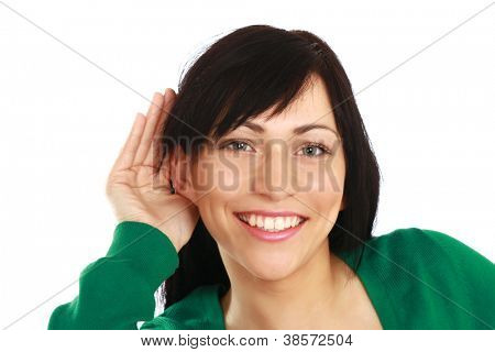 A young woman listening, isolated on white background