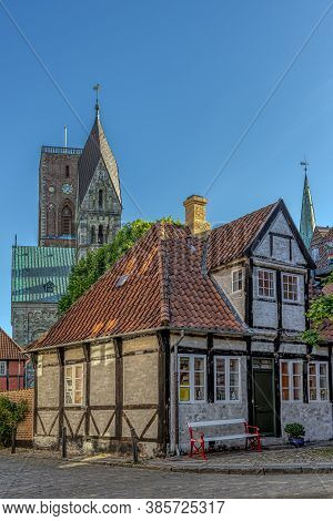 A Half-timbered House And The Ribe Cathedral In The Background, Ribe, Denmark, June 1, 2020