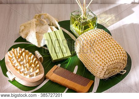 Natural Washcloth, Olive Soap And Wooden Comb On A Wooden Light Background, Top View, Concept Of Eco