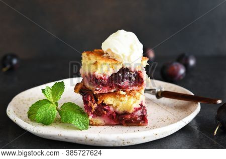 Cupcake With Plums And Vanilla Ice Cream On A Dark Background. Fruit Pie With Mint.
