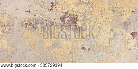 Old Cracked Weathered Painted Wall Banner Background Texture. Yellow Dirty Peeled Plaster Wall With