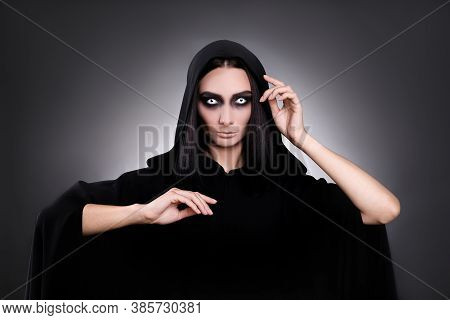 Mysterious Witch With Spooky Eyes On Dark Background