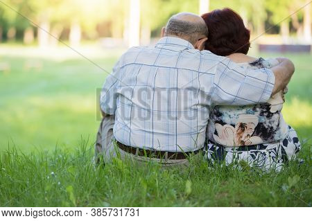Elderly Couple Outdoors In Summer.happy Elderly Couple On A Walk. Handsome Man And Woman Senior Citi