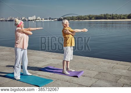 Joyous Woman And Her Husband Working Out Outdoors