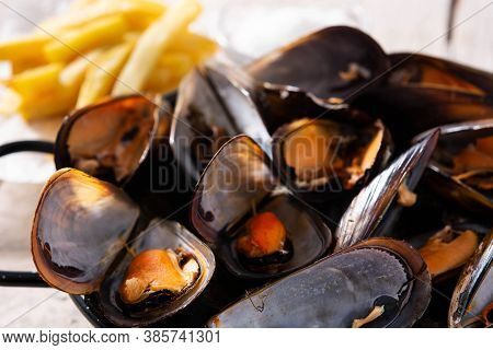 Moussels And French Fries Or Molues-frites. Typical Belgian Food. Close Up