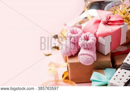 Pair Of Small Pink Baby Socks And Gift Box On Pink Background With Gift Present Boxes And Copy Space