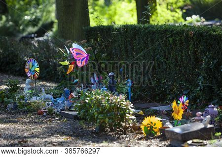Tombstones And Colorful Toys On A Part Of The Cemetery For Children In Rotterdam In The Netherlands