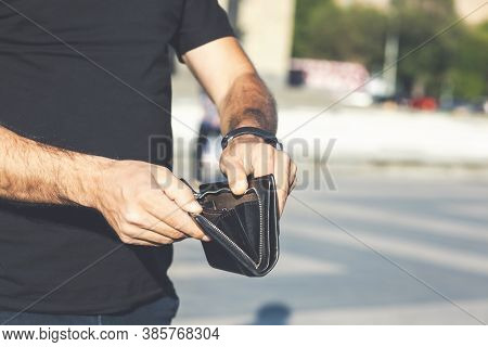 Man Takes Out Money From A Wallet