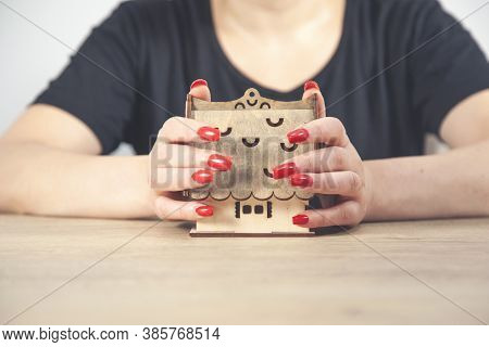 Woman Protecting Model Of House. Realty Investment Protection Concept. Selective Focus On House.