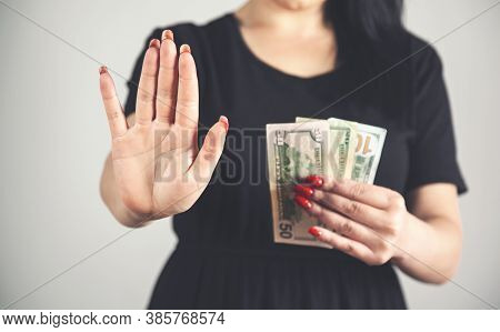 Young Woman Hand Stop Sign In Money