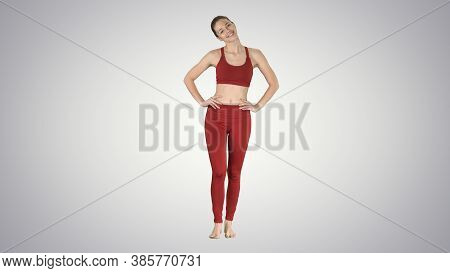 Mature Woman Stretching Her Neck And Walking On Gradient Backgro