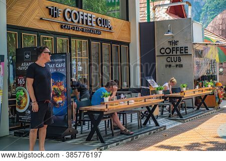 Krabi/thailand-22 July 2017:unacquainted Tourist Relaxing In The Coffee Cafe Beside Ao Nang Beach At