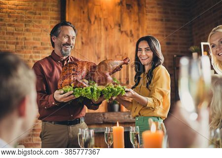 Cheerful Parents Carry Decorated Apples Stuffed Big Turkey Living Room Holiday Dinner Showing Chicke