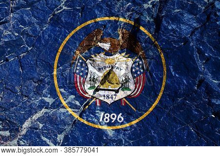 The National Flag Of The State Of Utah Usa On A Blue Background With A Seal In The Center, Surrounde