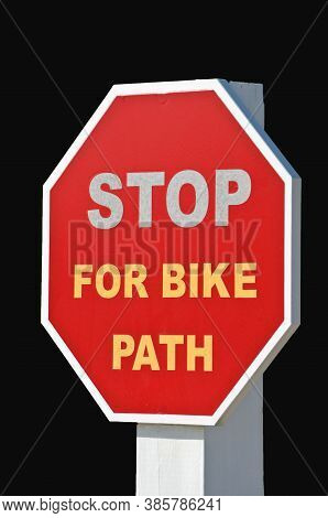 Stop For Bike Path Sign Isolated On A Black Background