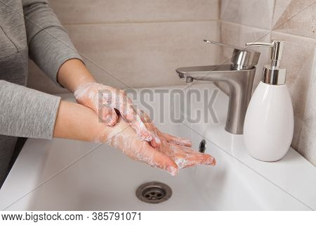 The Woman Properly Washes Her Hands, Washing Her Hands Between Her Fingers With A Lot Of Foam And So