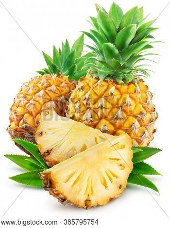 Pineapples with leaves and pineapple slices isolated on a white background. Clipping path.
