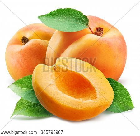 Apricots with leaves and apricot slices isolated on a white background. Clipping path.