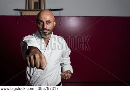 Powerful Karate Master With Focused Hand And Unfocused Face, Posing With Powerful Attitude In His Do