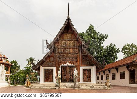 Buddhist Temple In Wat Pratu Pong At Lampang Province. An Ancient Temple Decorated With Ancient Lann