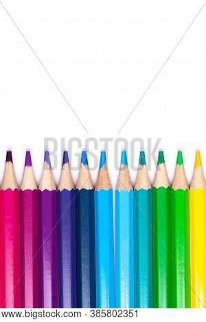 Multicolored Wooden Pencils In Rainbow Shades In Order On A White Isolated Background Mock Up, Verti
