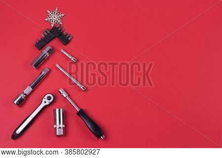 Creative Christmas Tree On Red Background, Made Of Wrenches.set Of Tools Supplies For Repair Car On