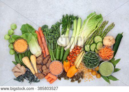 Immune boosting vegan health food with vegetables, herbs, supplement powder, legumes, pasta & dip very high in antioxidants, vitamins, minerals, smart carbs, carotenoids, protein & lycopene. Flat lay.