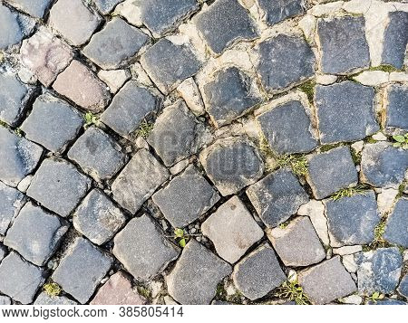 Close-up Old Paving Stones. Cobbled Street In Lviv, Ukraine. Old Broken Paved Street. Pavement Of St