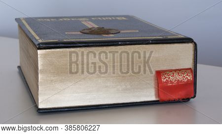 Holy Bible Special Edition Golden Side Hardcover In Side View With Blue Page Marker