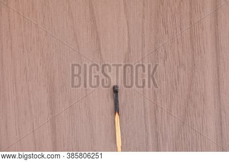 Matchstick Burning Wood, With Wooden Background In Top View