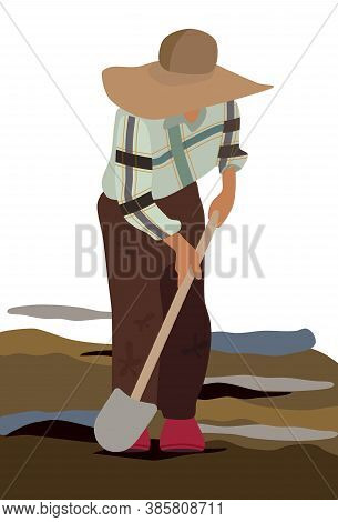A Farmer In A Wide-brimmed Straw Hat And Dirty Clothes Digs The Ground With A Shovel. Plow The Field