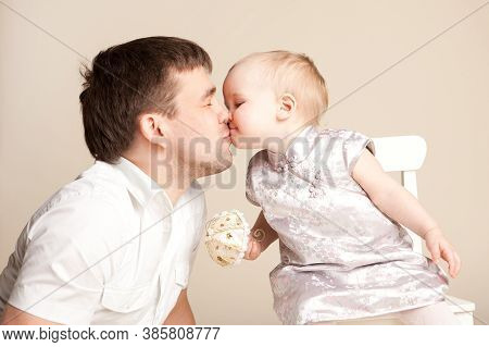 Happy Family. Dad Kisses Little Daughter. Baby Girl With Short Hair. Children Holiday, Birthday. Fat
