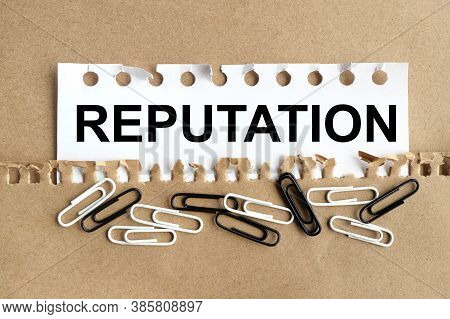 Reputation. Text On White Paper On Kraft Paper Background