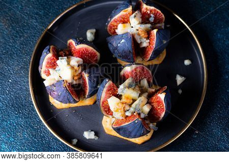 Appetizer With Figs And Blue Cheese. Roquefort Cheese. Salted Cracker. Cheese With Honey. Snack And