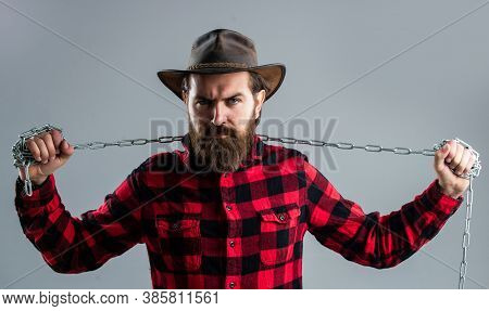 Do Not Give Up. Chained Up In Chains. Bearded Man Has Aggressive Look. Express His Strength. Male Po
