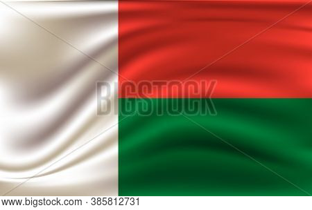 Realistic Waving Flag Of Republic Of Madagascar. Fabric Textured Flowing Flag Of Madagascar.