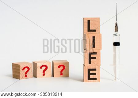 Four Wooden Blocks With Life Text Of Concept. The Abbreviation Life Formed By Wooden Blocks On A Whi