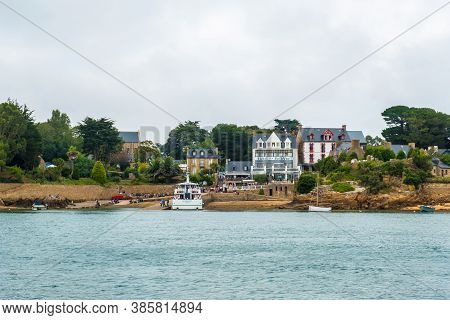 Ile De Brehat, France - August 27, 2019: View Of The Port-clos Ferry Landing And Coastal Hotels On I