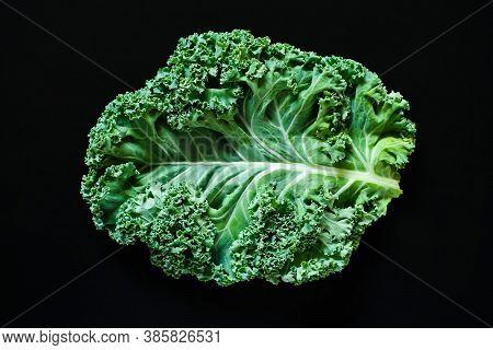 Fresh Raw Green Curly-leaf Kale Or Leaf Cabbage On Black Background. Healthy Food, Vegan Diet, Trend
