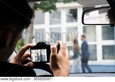 Private Detective Spying. Investigation And Surveillance With Camera
