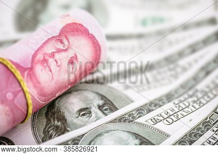 Banknotes Of 100 Us Dollars And 100 Chinese Yuan Renminbi, Concept Of Global Economy