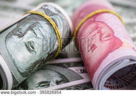 Macro Of Dollar Bills And China Yuan Or Renminbi Banknotes, Chinese And Us Economy Finance Commercia