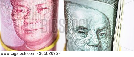 Banknotes Of One Hundred American Dollars And One Hundred Yuan From China. Chinese Market Valuation